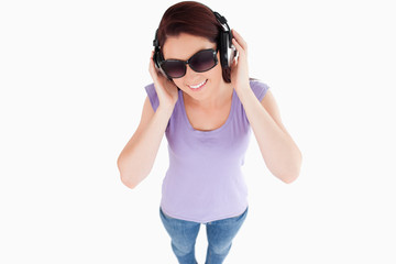 Cute Woman with headphones and sunglasses