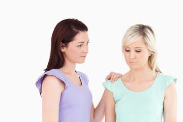 Charming women comforting her friend