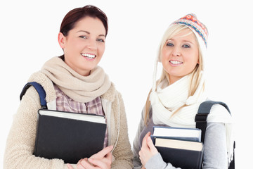 Female students with books looking