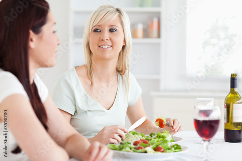 Portrait of Smiling Women eating salad