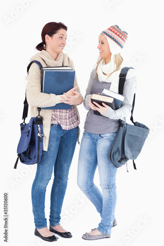 Students with books talking