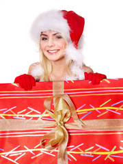 Girl in santa hat holding  gift box .