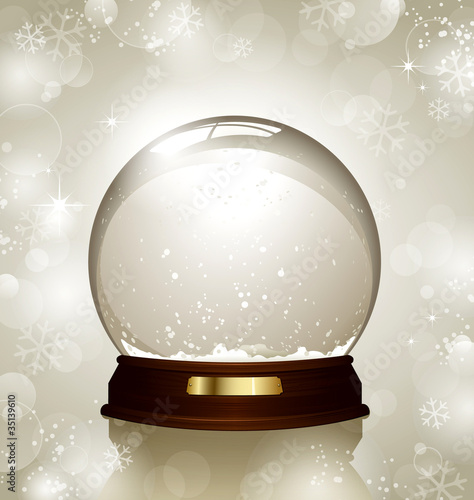 empty snowglobe against a bright defocused background