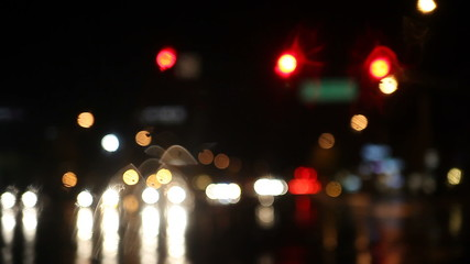 rainy night traffic at intersection