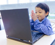 smile asian kid with laptop notebook