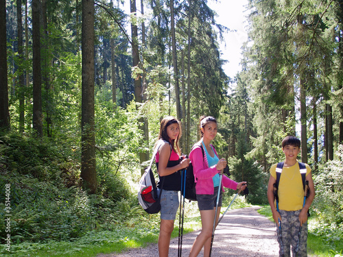 smiling kids hiking in the forest