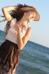 young happy woman on sea background