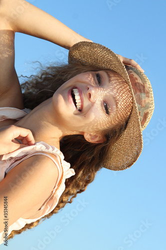 young smiling woman on sky background