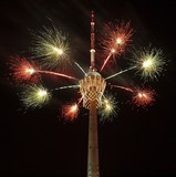 Biggest basket in the world on TV tower and fireworks. poster