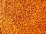 orange, terra-cotta colored wall