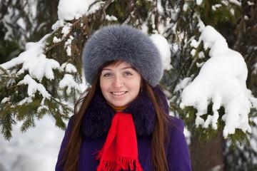 woman in coat and fur cap