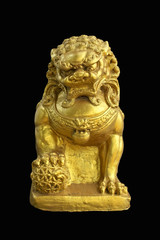 Statue of male guardian lion with the ball