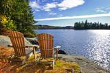 Fototapety Adirondack chairs at lake shore