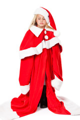 little girl sad in a oversized santa costume