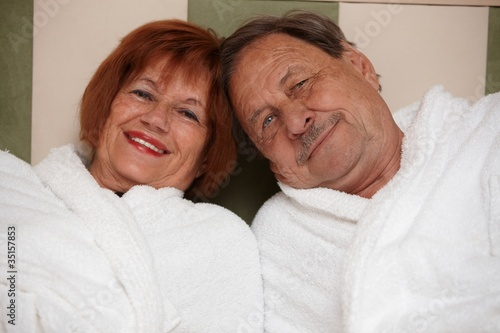 Happy elderly couple in bathrobe