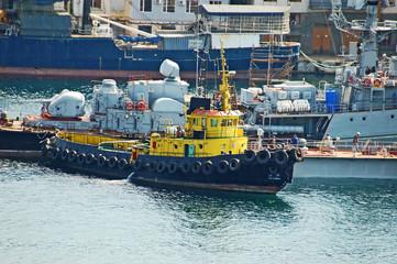 Tugboat at military ship at Sevastopol harbor, Ukraine
