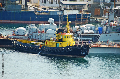 Tugboat at military ship at Sevastopol harbor, Ukraine