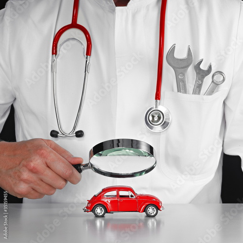 Checking a red car carfully with magnifier