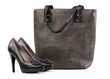 Pair of black female shoes and handbag over white