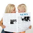 Mother and daughter reading newspaper together