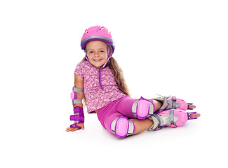 Little girl with roller skates resting