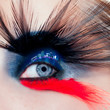 black bird woman eye makeup macro night city eyelid
