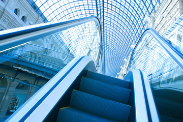 blue escalator in motion