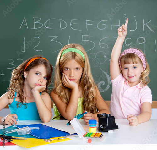 boring sad student with clever children girl raising hand