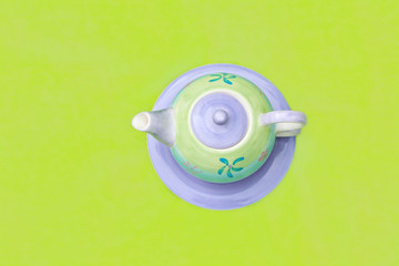 Lovely pastel teapot on green background