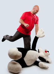 man fights with a toy animal