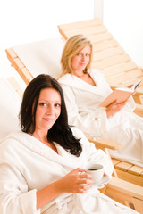 Beauty spa relax two women on sun-beds