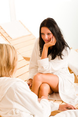 Beauty spa room two women relax chatting