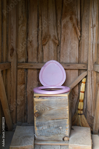 wooden outside toilet