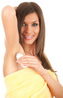 young woman in yellow towel using an antiperspirant