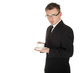 businessman in business attire standing drinking coffee