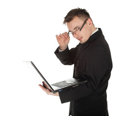 young businessman in black suit working on laptop