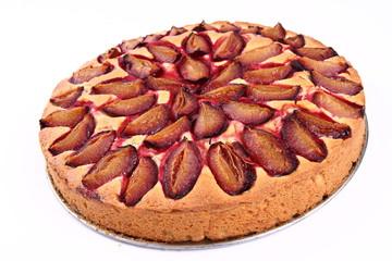 Plum pie on a white background