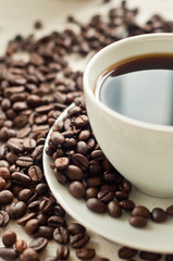 Coffee Beans with a cup of coffee