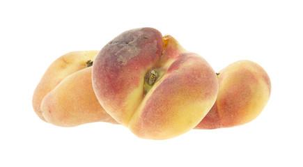 Three saturn peaches