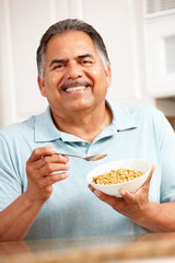 Senior man eating cereal