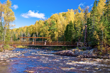 hiking over the baptism river, autumn