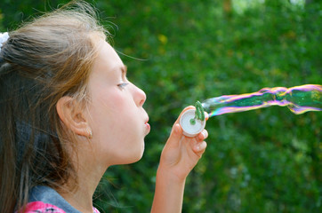 girl with soap-bubbles