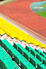rows of plastic chairs at the stadium