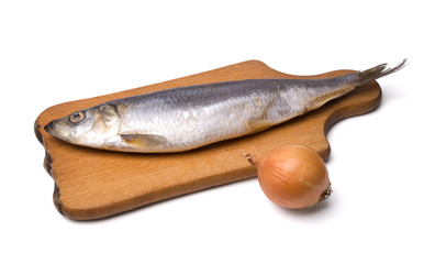 Herring with onion on kitchen board