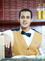 Cheerful arab barman