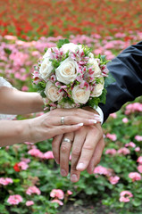 Wedding bouquet and bride and groom hands