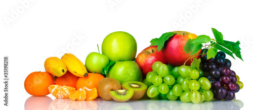 Ripe juicy fruits isolated on white