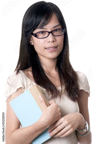 Asian woman holding a book