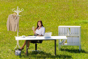Businesswoman in sunny meadow relax nature office