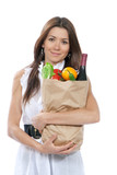 woman holding paper shopping bag full of groceries